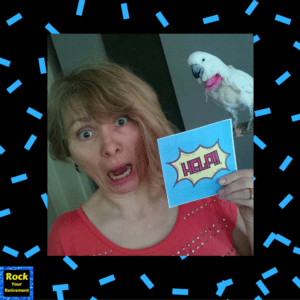 "Funny Photo of Kathe holding a ""help"" sign with her bird in the background"
